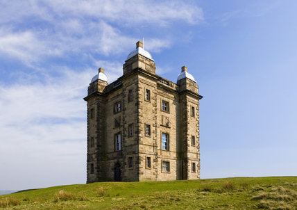 The Cage, an Elizabethan hunting tower modified by the architect Giacomo Leoni in the eighteenth century, on a windswept ridge in the medieval deer park at Lyme Park, Cheshire