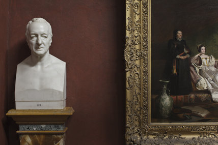 Close view of sculpture bust next to the painting SANCHO AND THE DUCHESS by Charles Robert Leslie RA, in the North Gallery at Petworth House, West Sussex