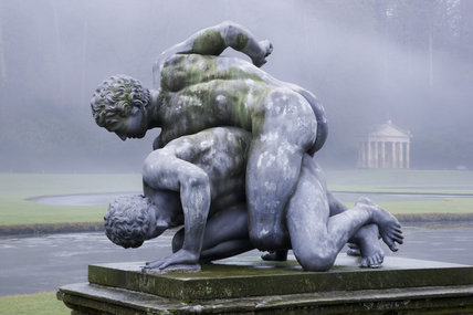Statue of The Wrestlers at Studley Royal Water Garden, North Yorkshire, photographed in the winter