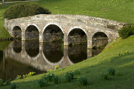 The Palladian Bridge reflected in the lake at Stourhead, Wiltshire, in March