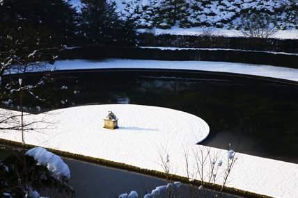 Snow at Studley Royal Water Garden, North Yorkshire, looking down over the Canal and Half-Moon Pond