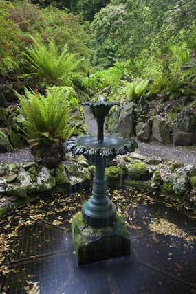 Fountain in The Fernery in the garden at Greenway, Devon, which was the holiday home of the crime writer Agatha Christie between 1938 and 1976