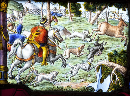 A sixteenth or seventeenth century Swiss-German stained glass panel with a deer hunting scene in the Hall at Upton House, Warwickshire
