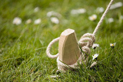 Guy rope and wooden peg in the garden at Trerice, Cornwall