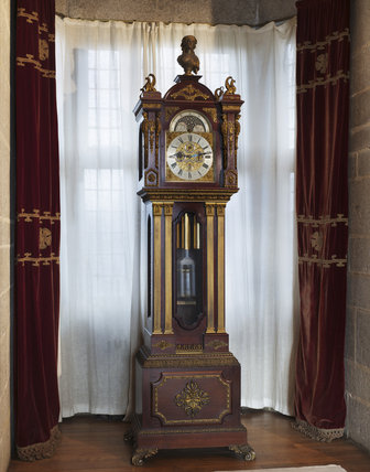 The eight-day chiming longcase clock built of mahogany by J.Smith & Sons of Clerkenwell, which was exhibited at the Paris Exhibition of 1900, in the Corridor at Castle Drogo, Devon.