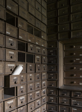 Close view of the wooden drawers in the Muniment or Evidence Room at Hardwick Hall, Derbyshire