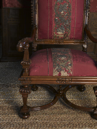 One of the pair of carved walnut high-backed chairs placed under the canopy in the Gallery at Hardwick Hall, Derbyshire