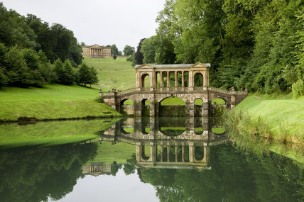 A view taking in the Palladian Bridge and, in the distance, the house (not owned by the NT) at Prior Park Landscape Garden, Bath