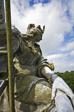 Statue of Minerva on the roof at Lyme Park, Cheshire, looking over the entrance courtyard