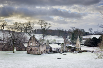 Dramatic winter view of the remains of the Guesthouse at Fountains Abbey, North Yorkshire