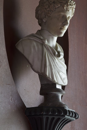 Close view of sculpture bust in a niche in the North Gallery at Petworth House, West Sussex
