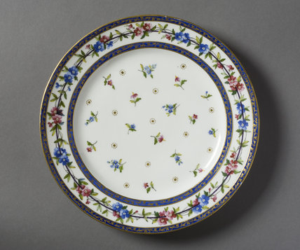 A dinner plate from a Sevres dinner service at Hinton Ampner, Hampshire