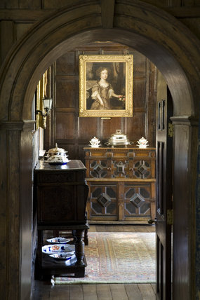 View through the arched doorway into the Dining Room at Baddesley Clinton, West Midlands