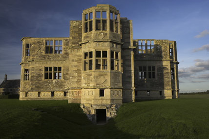 The south wing entrance of Lyveden New Bield near Oundle, Northamptonshire, with the west and east wings visible to either side