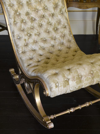 Button-backed, upholstered, rocking chair in the Morning Room at Greenway, Devon, which was the holiday home of the crime writer Agatha Christie between 1938 and 1976
