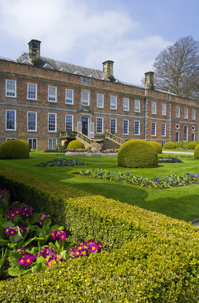 The view across the Victorian Parterre in spring towards the garden front at Erddig, Wrexham, Wales