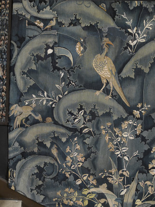 Tapestry with birds and foliage, recently conserved, on the stairway on the Upper Landing at Hardwick Hall, Derbyshire