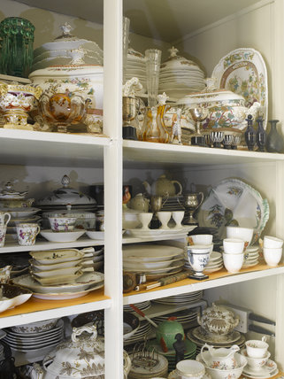 A cupboard of assorted chinaware in the Winter Dining Room at Greenway, Devon, which was the holiday home of the crime writer Agatha Christie between 1938 and 1976