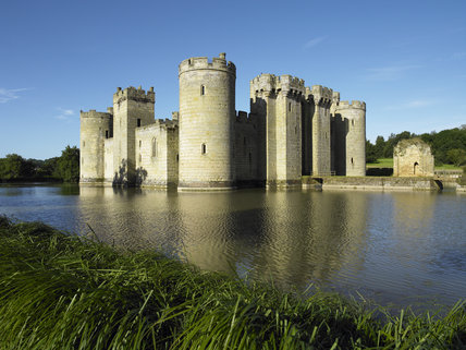 The East Range and North Range with the Gatehouse and bridge to Bodiam Castle, East Sussex, built between 1385 and 1388