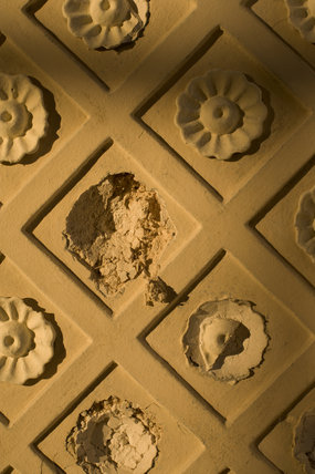 Damage to the plasterwork flower motif of the window recess in the Rotunda, one of Capability Brown's