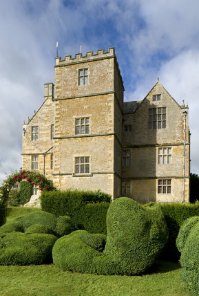The unusual topiary shapes in front of the east front of Chastleton House, Oxfordshire