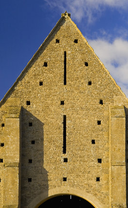 Close view of the end of the mid-thirteenth century monastic Great Coxwell Barn near Faringdon in Oxfordshire