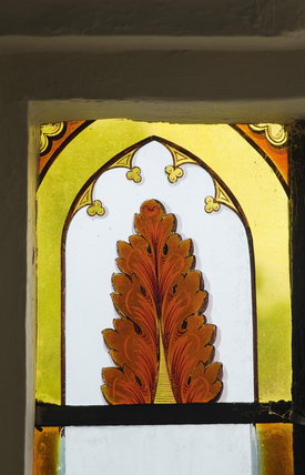 Late eighteenth century coloured glass in the bay window on the Staircase at Newark Park, Gloucestershire