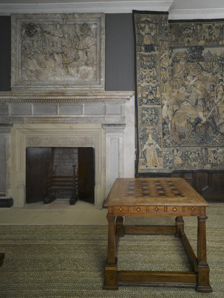 A marquetry topped games table, English c.1580, in the Withdrawing Chamber at Hardwick Hall, Derbyshire.