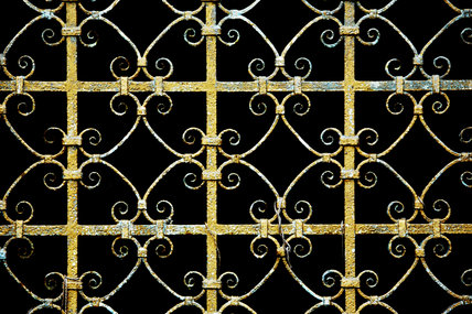 Ornamental wrought-ironwork of a garden gate at Cliveden, Buckinghamshire