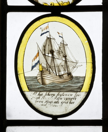 Painted glass oval featuring a ship with a French flag, set into a window in the Great Hall at Montacute House, Somerset
