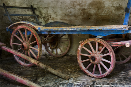 Old farm carts in an outbuilding on the estate at Godolphin House, near Helston, Cornwall