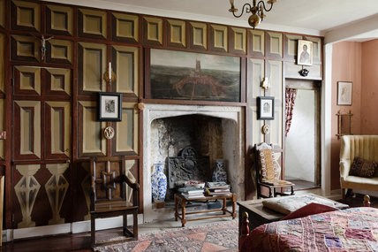 The Tudor Bedroom at Newark Park, Gloucestershire, looking towards the sixteenth century fireplace