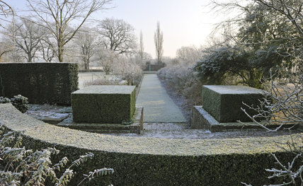 Looking towards the Azalea Border in January at Sissinghurst Castle Garden, near Cranbrook, Kent