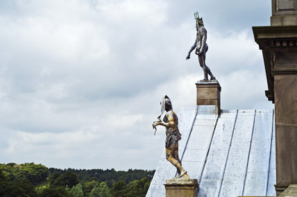 Statues of Neptune and Venus on the roof at Lyme Park, Cheshire