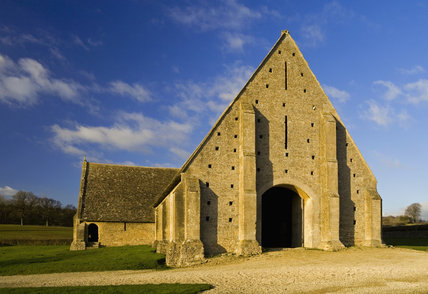 End view of the mid-thirteenth century monastic Great Coxwell Barn near Faringdon in Oxfordshire