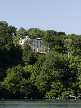 The house seen from the approach along the Dart Estuary at Greenway, Devon, which was the holiday home of the crime writer Agatha Christie between 1938 and 1976
