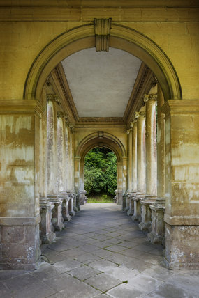 A view through the loggia of the Palladian Bridge at Prior Park Landscape Garden, Bath