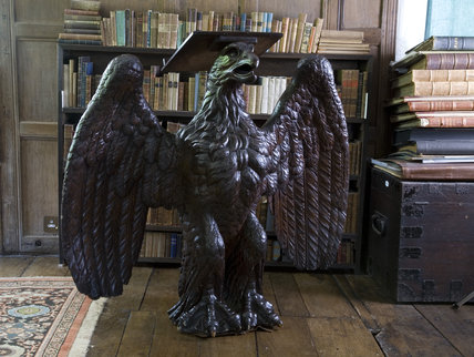 Oak lectern in the form of an eagle, originally a ship's figurehead of c.1800, in the Library at Baddesley Clinton, West Midlands.