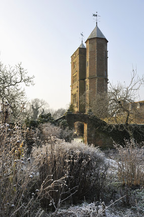 The Elizabethan tower with the White Garden in the foreground, in January at Sissinghurst Castle Garden, near Cranbrook, Kent