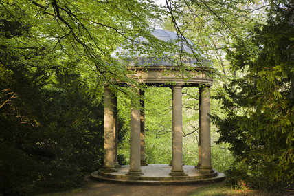 The domed rotunda of the Temple of Fame on the valley side at Studley Royal Water Garden, North Yorkshire