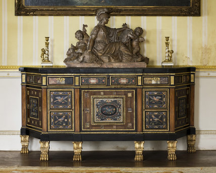 A Regency rosewood and ebonised veneered commode  in the South Drawing Room at Hinton Ampner, Hampshire