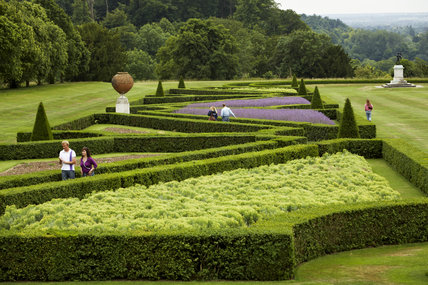 Visitors on the Parterre garden in June at Cliveden, Buckinghamshire