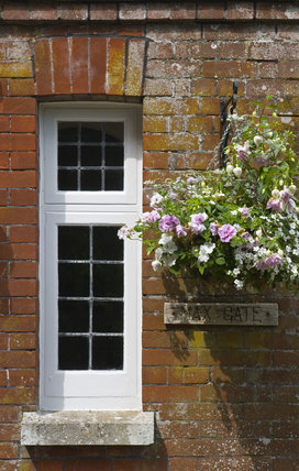 Small window and a hanging basket at the entrance to Max Gate, the home of the novelist and poet Thomas Hardy from 1885 until his death in 1928, Dorchester Dorset