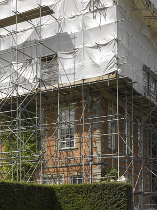 Outdoor conservation - close view of the scaffolding and protective cover whilst working on the roof at Hanbury Hall, Worcestershire