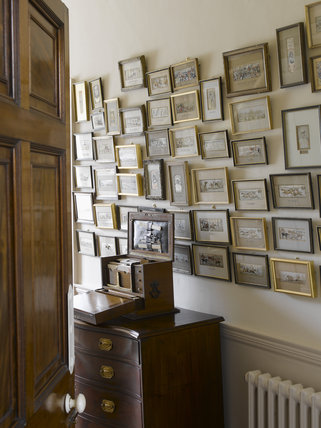 The Fax Room with the collection of Stevengraphs framed silk pictures at Greenway, Devon, which was the holiday home of the crime writer Agatha Christie between 1938 and 1976