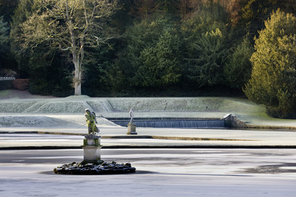 The statue of Neptune in winter in the Moon Pond at Studley Royal Water Garden, North Yorkshire