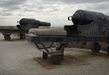 Two 12-tonne guns on iron carriages in the gun emplacements at the Needles Old Battery, built in 1862 following the threat of a French invasion, on the far western point of the Isle of Wight