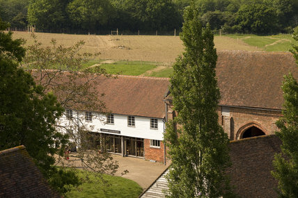 View from the Tower of the Granary restaurant and new vegetable garden behind it at Sissinghurst Castle, Kent