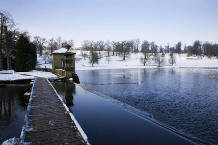 The Weir and lake at Studley Royal Water Garden, North Yorkshire, in snow