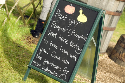 Sign about planting your own pumpkin seeds at Trerice, Cornwall, part of a Food Glorious Food event